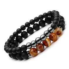 Arranged out of healing crystal beads, this beaded bracelet for him radiates to deliver a palpable masculine energy. Hematite is a natural stone shown to absorb negativity and promote tranquility, whereas agate is believed to cultivate intuition and inspire alignment of the chakras. Together this duo is unmatched in terms of equalizing.  Hematite is a stone that grounds and protects. It strengthens our connection with the earth, giving us the feeling of being safe and secure.  It gives…