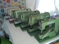 Elna sewing machine collection. From left to right- zig zag model, tan Supermatic (no date), two tone green Supermatic (Sept 1961), green Supermatic (Nov 1953), green Transforma (Feb 1956) and Grasshopper (Feb 1951).