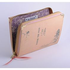 Winne the Pooh, book clutch by PS Besitos The cover is made of printed on cotton fabric and binded, as a normal book would be. It's finished with golden metal corners to embellish and protect the clutch.