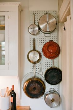 using a pegboard for holding pots and pans, nice idea for small spaces.