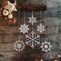 Items similar to Christmas decoration - snowflakes mobile - elegant Christmas decoration - Christmas holiday decor - 3 crochet snowflake and wood ornament on Etsy Elegant and delicate holiday decoration. Every single piece of this decoration is handmade w Diy Christmas Fireplace, Diy Christmas Snowflakes, Elegant Christmas Decor, Snowflake Craft, Wooden Snowflakes, Snowflake Decorations, Crochet Snowflakes, Christmas Holidays, Christmas Crafts