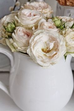 Milk jug with sweet flowers