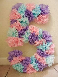 DIY under the sea mermaid birthday party ideas. Tissue paper number.