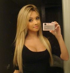 Usually don't think dark eyes dark skin looks good with blonde hair but this girl rocks it!