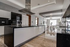 Sleek! Black and White... Lacquered cabinets... Neutral beige floor instead of trying to match black or white...