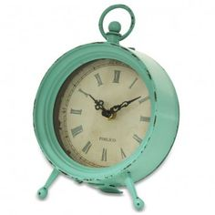 Metal Side Clock - Sea Foam  A graceful clock for your side table, this teal metal clock has a charming old-fashioned look. $49.99