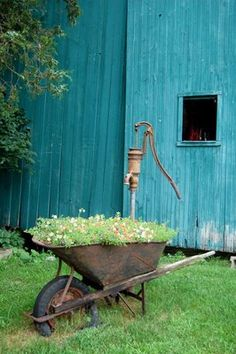 love the rusty wheelbarrow with flattened tire. and the old water pump is awesome too.