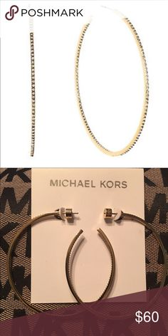 "Michael Kors Hoop Earrings Michael Kors Gold Tone Brilliance Statement Inside Out Pave Hoop Earrings Hit the town in hoop earrings destined to steal the spotlight.  Tiny pave crystals lend the perfect amount of sparkle to these gold-tone stainless steel hoop inside out earrings.Post backings Measurements: 2.5"" diameter Michael Kors Jewelry Earrings"