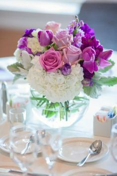 Purple & white reception centerpiece design.