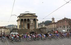 Cyclists cross through Piazza Gran Madre in Torino during the 14th stage of the Tour of Italy cycling race, the 206 km leg from Cherasco to Cervinia, on May 19, 2012, in Cervinia. AFP PHOTO / LUK BENIESLUK BENIES/AFP/GettyImages