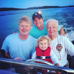 Four Generations of Scotts : That's me in the back with my Annalise at the helm, my father, a.k.a. Grandy on the starboard and my grandfather, a.k.a. Who Who on the port side of the Boston Whaler, cruising Squam Lake.