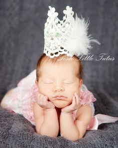 Your little princess will look amazing for her first photo session! This little lace crown is stunning with handmade details & whimsical style. Tiny crown is very lightweight to gently sit on her royal head. No clips or attatchments are needed.      Luxurious handcrafted with the finest lace details. Features ivory lace with marabou and crystal details. Crown is made to keep it's shape. Makes a great gift for a baby heirloom, cake topper and more!