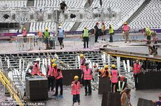 Operation clean-up: Workers had a tough job on their hands to clean up the mess from last night- August 13, 2012.  .......Olympics 2012- London, England