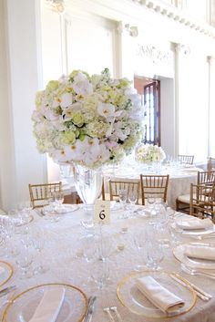 Lush centerpieces full of hydrangeas, orchids, and jewles by Michael Daigian Design.