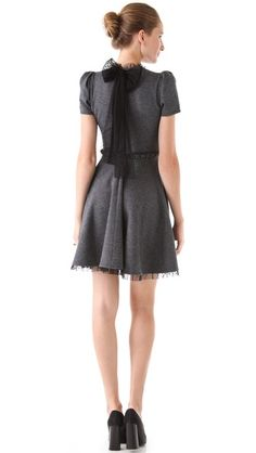 The sweater dress is a staple for your fall wardrobe- we love the neck tie, it gives this look a bold modern twist.