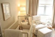 nurseries - jute rug taupe drapes white glider ottoman gray piping white crib  Chic, sophisticated gender neutral nursery design with white glider