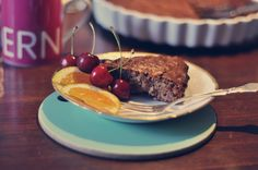 Almond cake served with orange and cherries