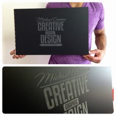 Custom graphic design portfolio book with engraving treatment on matte black acrylic