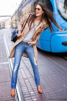 Camel trench coat, grey t-shirt, skinny jeans, camel shoes & belt, black shoulder bag
