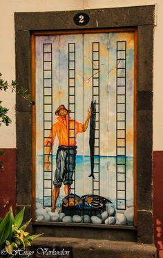 A painted door in Funchal, Madeira, Portugal - photo by Hugo Verkoelen, via Flickr