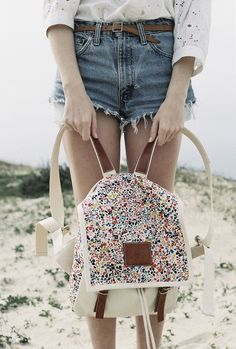 A floral backpack can add a touch of cute to your outfit.