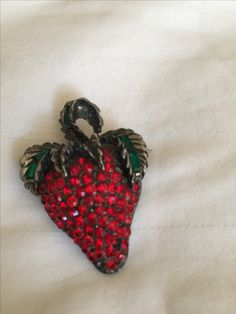 """Old Strawberry pin.  Someone said once """"you like strawberries because they resemble a heart❤️"""" Perhaps."""
