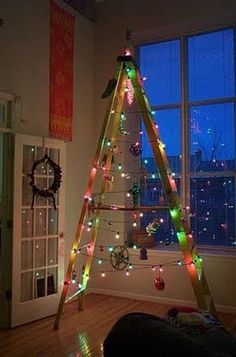 Ladder Christmas Tree:   I'm a sucker for ladder-inspired decor, and this is a beautiful example. They've found a tall, narrow vintage ladder, and the added lights echo the Christmas tree shape and add a modern flair.