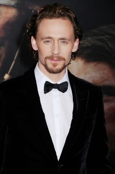 """tom hiddleston latest   Tom Hiddleston walks the red carpet at the premiere of """"War Horse"""" in ..."""