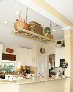 I have always wanted to do this, a ladder in the kitchen for pot hanging and storage.