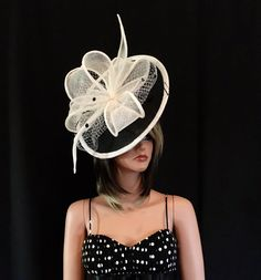 2017 collection.Black and white  fascinator. Kentucky Derby
