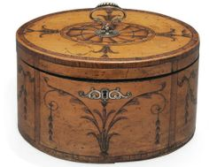 Tea chest circa 1790 — inlaid with swags and bell-husks, the cover with an oval patera, kingwood crossbanding and silver handle and escutcheon, the interior fitted with a pair of lift-out 'D' form caddies with locks, from teasquared
