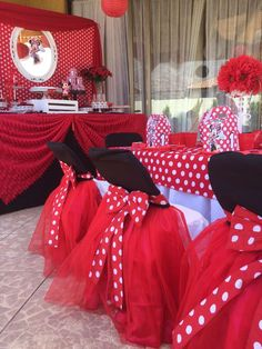 Loving the red tule skirts with pretty red polka dot bows decorating the chairs at this Minnie Mouse