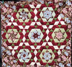 Kaleidoscope quilted wall hanging burgundy pink and green by KellettKreations on Etsy