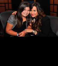 Demi Lovato and sister Madison De La Garza attend a Live Chat at Cambio Studios on July 21, 2011 in Hollywood, Calif.