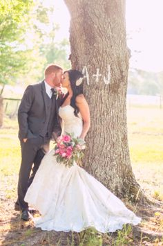 backlighting, romantic kiss, wedding photography, bridal gown, beautiful couple, stylish wedding, bridal bouquet, pink roses, sweetness, tree, initials, A + J ::Jessica + Adam's private, outdoor wedding portrait photography session:: with Nikki