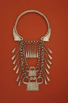 "Very elaborate twisted neckring with many dangles and two ""soul locks"". Golden Triangle: Hmong people; early to mid 20th c. Made of good quality silver."