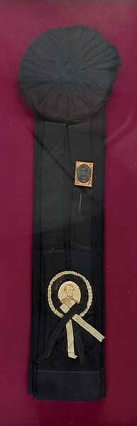 """Spectacular and rare Abraham Lincoln Mourning Cockade with albumen photograph of Lincoln and ferrotype stick pin with portrait of Lincoln. Large 9.5 """" x 22"""".  *s*"""