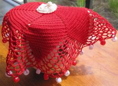 Description Vintage Hand Crochet/Filet JUG COVER 25cms Red Cotton with Red and White Beads Raised Rosette in Center. 'Never Used'