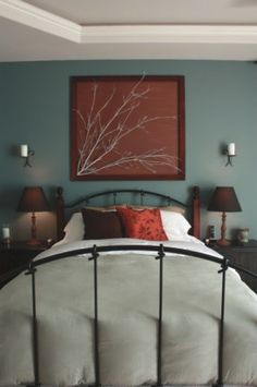 A regular frame, fabric of your choice (wrapped around the back piece), and a painted branch.  Easy peasy!