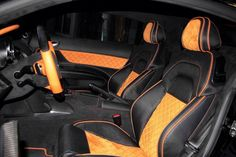 Black and orange, diamond tuck auto upholstery.