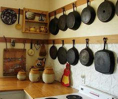 I like the look of all those cast iron pans, but 3 is all I have. Hanging them like this would be cute in my dream blue, black, and white kitchen.