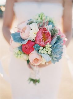 bridal bouquet with corals, cool blue tones and soft pinks. Peonies and succulents... yummmmm.