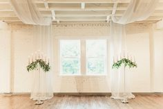 BRIK Venue | Fort Worth | Texas | Wedding | Ceremony | Candelabra | Gold Candles | Drapery | Grey Linen | Greenery | Industrial | Warehouse | Wood Floors | White Brick | Ashley Errington Photography | Fig Floral