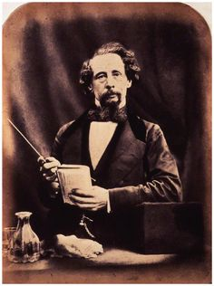 Charles Dickens  by (George) Herbert Watkins  albumen print, arched top, 29 April 1858.