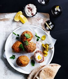 Recipe for Middle Eastern Scotch eggs with tahini yoghurt-change the burghul to quinoa and use GF breadcrumbs and flour.