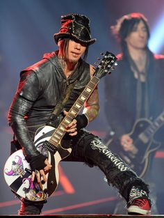 DJ Ashba Photos Photos - Guitarist Dj Ashba of Guns N' Roses performs at The Joint inside the Hard Rock Hotel & Casino during the opening night of the band's second residency, 'Guns N' Roses - An Evening of Destruction. No Trickery!' on May 22, 2014 in Las Vegas, Nevada. - Opening Night of Guns N' Roses' in Vegas