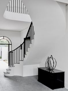 Originally built in 1983, this mock Georgian home has undergone a major renovation by Melbourne-based Robson Rak, presenting a pleasant surprise upon entry.