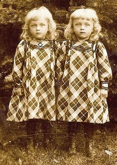 twins - Gee whiz, these old photos sure can make cute kids look creepy!