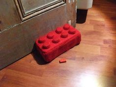 How cute is this knit Lego-style doorstop? Made with a brick, yarn and some bottlecaps. Free pattern at Instructables.