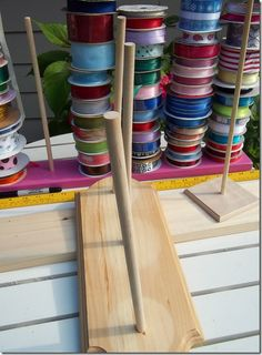 Another DIY ribbon holder which you can customize to fit your space and spool needs.  :D